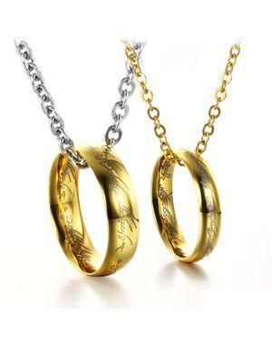 пара золотых колец на цепочках
