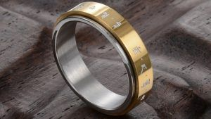 Вращающиеся серебряные и золотые кольца