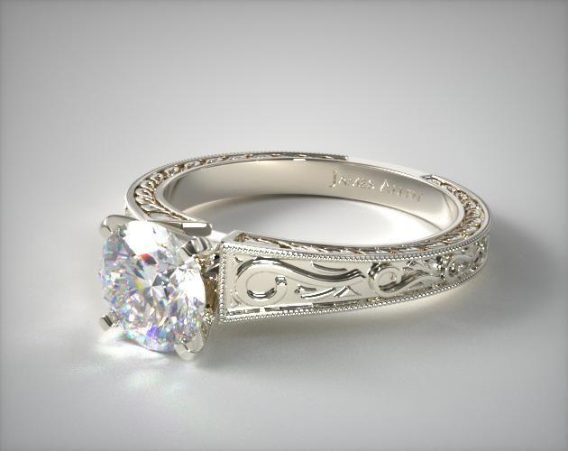 Завитки на этом винтажном платиновом обручальном кольце были типичными для эдвардианского дизайна