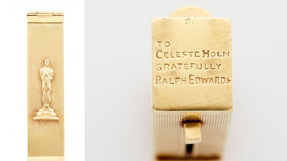 Эта подставка для губной помады из 14-каратного золота украшена статуэткой «Оскар»