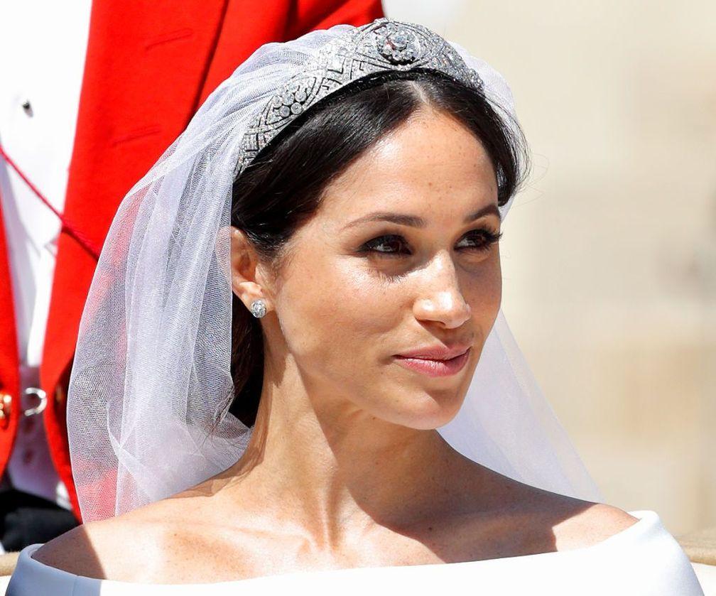 Меган, герцогиня Сассекская, едет в карете после церемонии бракосочетания с принцем Гарри, герцогом Сассекским