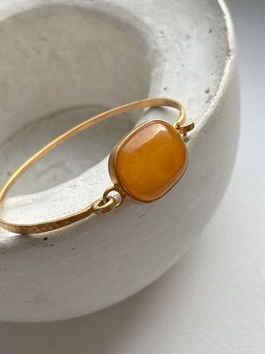 Золотые кольца с янтарем: особенности, как выбрать и носить