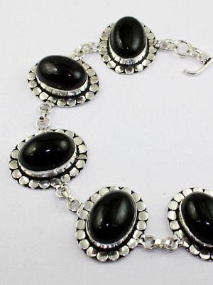 Женский серебряный браслет с черным ониксом