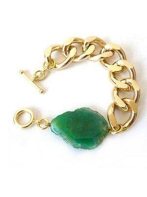золотой браслет с крупным камнем