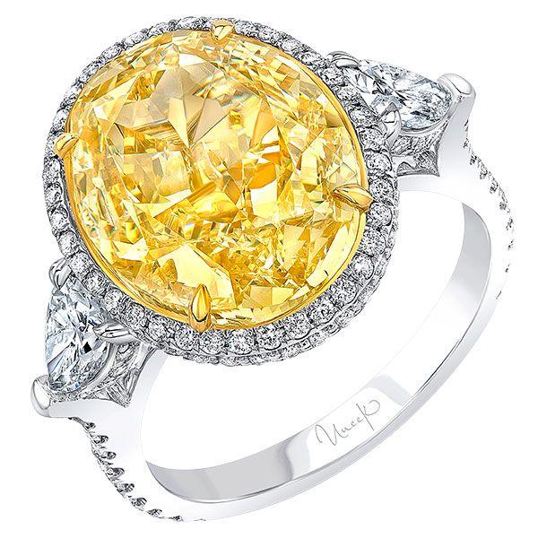 Юбилейное кольцо из белого и желтого золота 18 карат с овальным фантазийным желтым бриллиантом 8,01 карата; бренд Uneek
